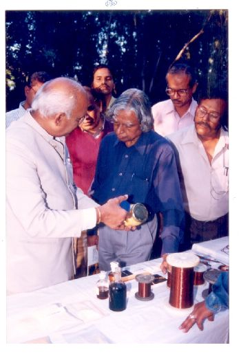 Dr. K. V. C. Rao explaining products to Dr. Kalam