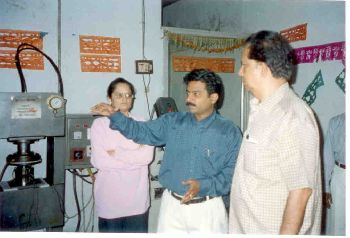 Naveen Chandra explaining to             Dr. Madhavan Nair, Former ISRO Chairman